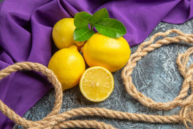 前视图新鲜柠檬与绳索